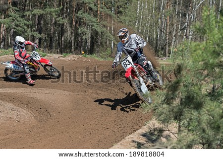 Lytkarino, Russia - April 26, 2014: Riders pass route in action during motorcross motor club Forsazh event in Lytkarino district, Moscow region.