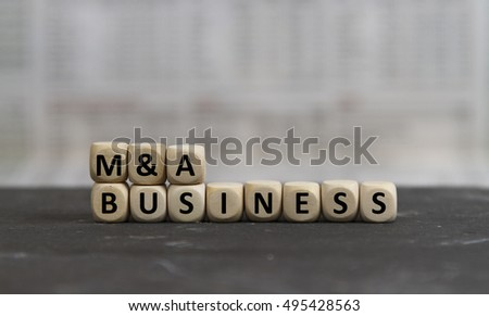 M&A Business word built with wooden letters