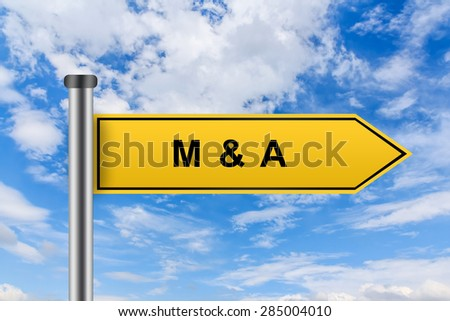 M&A or Merger and acquisition words on yellow road sign on blue sky - stock photo