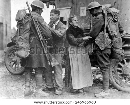 M. and Mme. Baloux of Brieulles-sur-Bar, France, endured German occupation for four years, greeting American soldiers in the last days of WWI. Nov. 6, 1918.