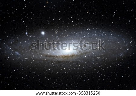 M31 Andromeda spiral galaxy placed about 2,5 million light years from Earth - stock photo