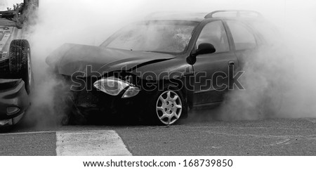 M'CHIGEENG, ONTARIO, CANADA-OCTOBER 1, 2008: Desaturated photo of a mock car accident, staged by police, fire, ambulance, and victim services, to educate students on the dangers of impaired driving.  - stock photo