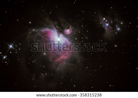 M42 Orion Nebula situated in the Milky Way about 1300 light years from Earth - stock photo