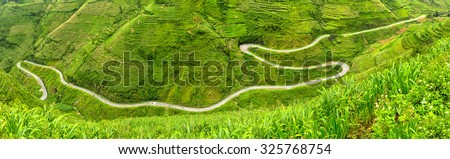 Ma Pi Leng Pass of the four most treacherous and beautiful high 20km in length 2,000m man exploring and conquering the beautiful stretch of road in Ha Giang, Vietnam - stock photo