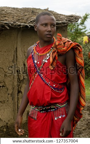 MAASAI MARA, KENYA-DECEMBER 27: Maasai in traditional clothes 27 December, 2012 at Maasai Mara, Kenya. The Maasai are the most famous tribe in Africa. - stock photo