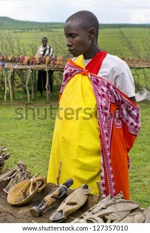 MAASAI MARA, KENYA-DECEMBER 27: Unidentified woman sells traditional souvenirs 27 December, 2012 at Maasai Mara, Kenya. The Maasai are the most famous tribe in Africa. - stock photo