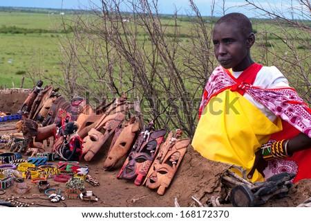 MAASAI MARA, KENYA-DECEMBER 27: Unidentified woman sells traditional souvenirs 27 December, 2012 in Maasai Mara, Kenya. The Maasai are the most famous tribe in Africa.  - stock photo