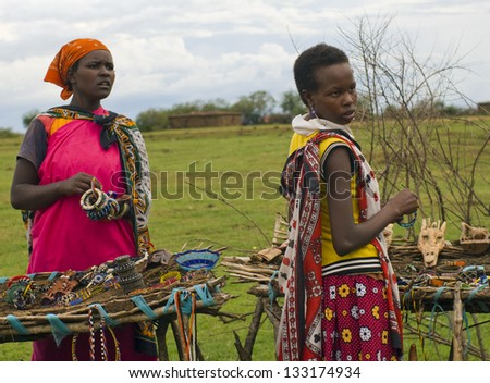 MAASAI MARA, KENYA-DECEMBER 27: Unidentified women sell traditional souvenirs 27 December, 2012 at Maasai Mara, Kenya. The Maasai are the most famous tribe in Africa. - stock photo
