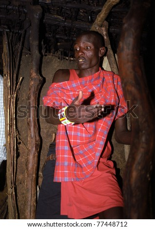 MAASAI MARA, KENYA - FEBRUARY 4: Maasai man in his hut, 4 February , 2004 at Masaai Mara, Kenya. The Maasai are the most famous tribe in Africa. They are nomadic and live in small villages. - stock photo