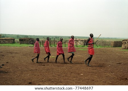 MAASAI MARA, KENYA - FEBRUARY 4: Maasai morani's numba dance, 4 February , 2004 at Masaai Mara, Kenya. The Maasai are the most famous tribe in Africa. They are nomadic and live in small villages. - stock photo
