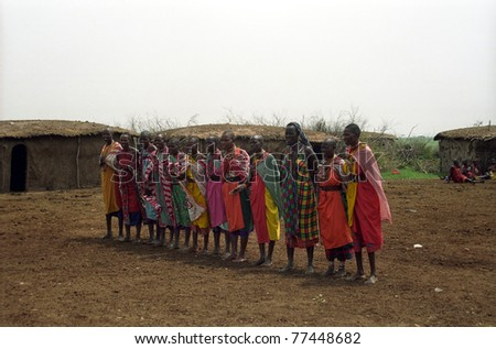 MAASAI MARA, KENYA - FEBRUARY 4: Maasai women in the village, 4 February , 2004 at Masaai Mara, Kenya. The Maasai are the most famous tribe in Africa. They are nomadic and live in small villages. - stock photo
