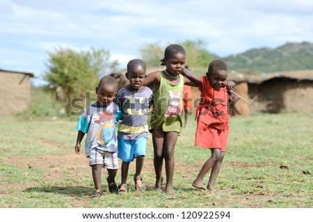 MAASAI MARA, KENYA - NOVEMBER 10: Group of unidentified African children on November 10, 2012 in Maasai Mara, Kenya. Maasai are a Nilotic ethnic group of semi-nomadic people located in Kenya. - stock photo