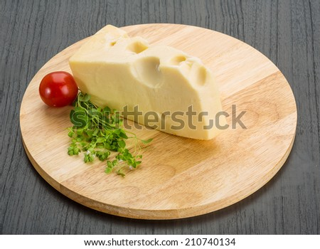 Maasdam cheese on the board with oregano