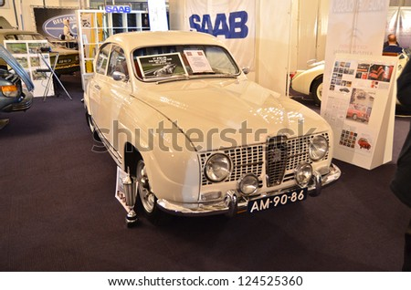 MAASTRICHT, HOLLAND - JANUARY 12: Saab 96, winner of best club car at InterClassics 2013 Classic Cars Event, January 12, 2013 - stock photo