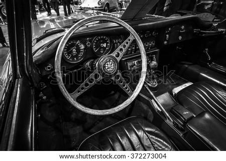 MAASTRICHT, NETHERLANDS - JANUARY 14, 2016: Cab of a sports car Jaguar E-Type. Black and white. International Exhibition InterClassics & Topmobiel 2016 - stock photo