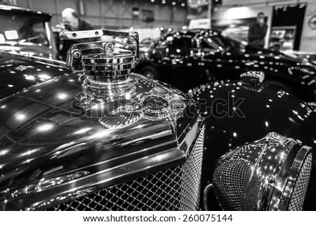 MAASTRICHT, NETHERLANDS - JANUARY 09, 2015: Hood ornament of a race car Bentley, circa 1920-1930. Black and white. International Exhibition InterClassics & Topmobiel 2015 - stock photo
