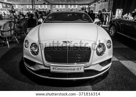 MAASTRICHT, NETHERLANDS - JANUARY 14, 2016: Personal luxury car Bentley Continental GT V8S, since 2016. Black and white. International Exhibition InterClassics & Topmobiel 2016 - stock photo