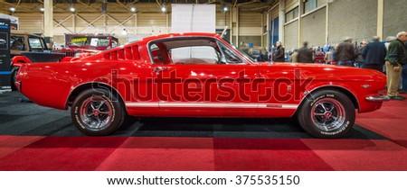 MAASTRICHT, NETHERLANDS - JANUARY 15, 2016: Pony car Ford Mustang GT (first generation), 1965. International Exhibition InterClassics & Topmobiel 2016 - stock photo