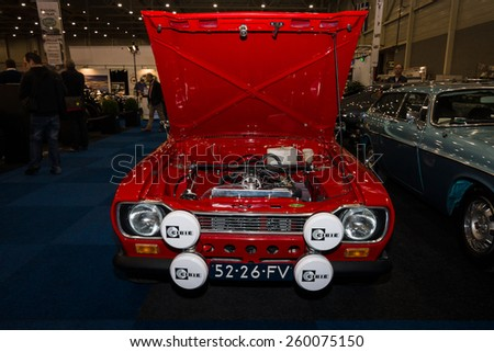 MAASTRICHT, NETHERLANDS - JANUARY 09, 2015: Small family car Ford Escort RS1600. Front view. International Exhibition InterClassics & Topmobiel 2015 - stock photo