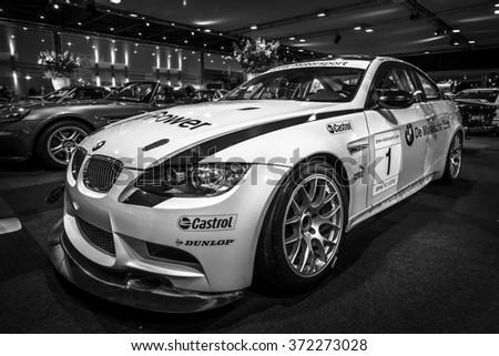 MAASTRICHT, NETHERLANDS - JANUARY 14, 2016: Sports car BMW M3 GT4, 2009. Black and white. International Exhibition InterClassics & Topmobiel 2016 - stock photo