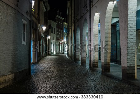 MAASTRICHT, NETHERLANDS - JANUARY 16, 2016: Street in the evening lights in the historic center. Maastricht is the oldest city of the Netherlands and the capital city of the province of Limburg.
