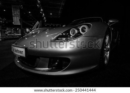 MAASTRICHT, NETHERLANDS - JANUARY 08, 2015: Supercar Porsche Carrera GT (Project Code 980), 2005. Black and white. International Exhibition InterClassics & Topmobiel 2015