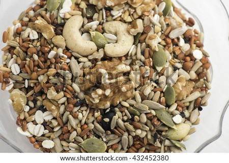 Macadamia nuts, walnuts, cashews, almonds and various healthy nuts in a glass bowl - stock photo