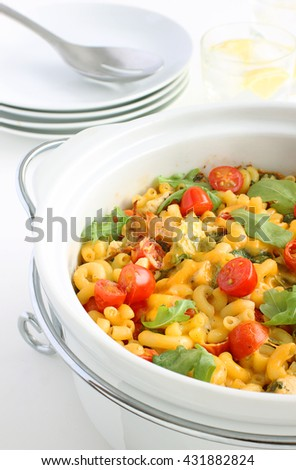 Macaroni and cheese, a festive, colorful side dish to serve with your Christmas dinner, a popular favorite with kids and adults - stock photo