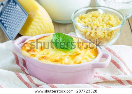 Macaroni and cheese baked in a mini cocotte - stock photo