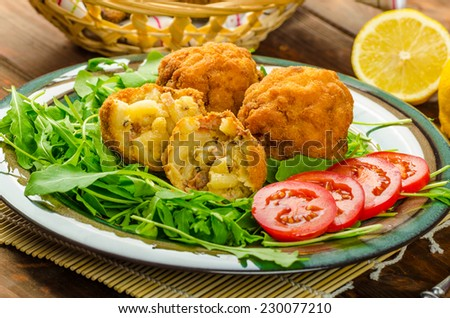 Macaroni and cheese balls, salad of arugula and healthy wholemeal bread - stock photo