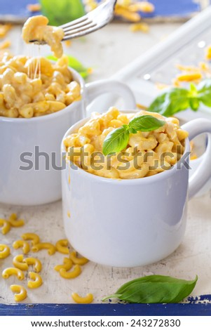 Macaroni and cheese homemade served in mugs - stock photo