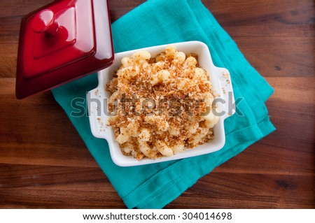 macaroni and cheese noodles in single serving size with breadcrumb topping - stock photo