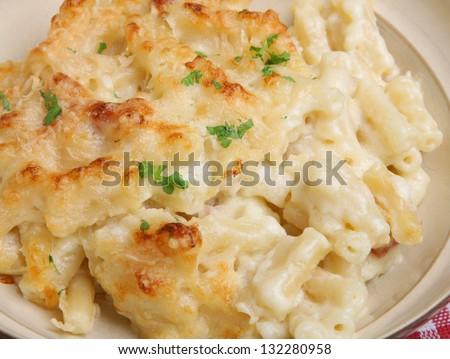 Macaroni cheese in beige bowl. - stock photo