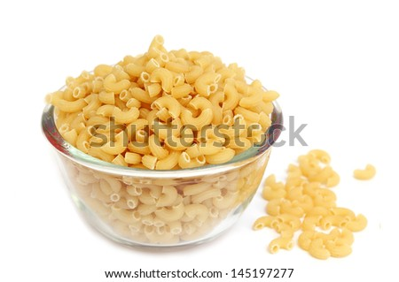 Macaroni in a glass bowl on white background