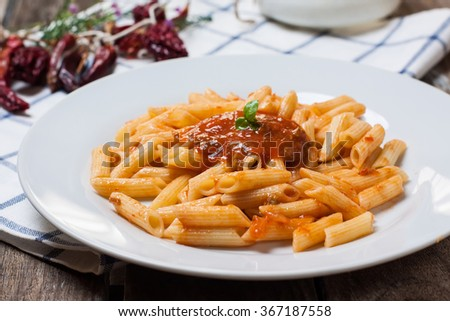 macaroni pasta with hot chili tomato sauce and basil - stock photo