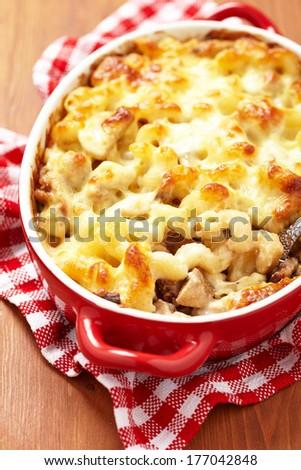 Macaroni with cheese, chicken and mushrooms - stock photo