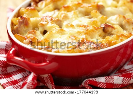 Macaroni with cheese, chicken and mushrooms - stock photo