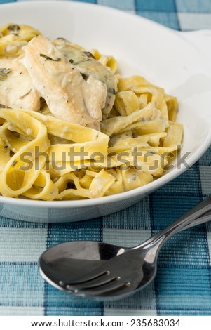 macaroni with chicken fillet in white bowl. Vertical image. - stock photo