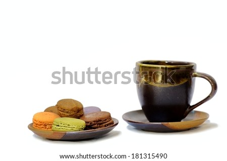 macarons with a cup of coffee on isolated white background.