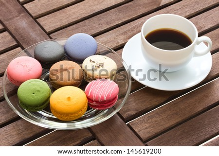 macarons with black coffee in wood table - stock photo