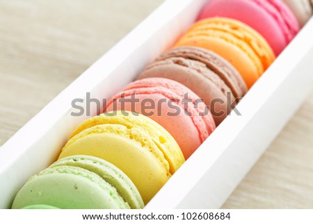 macaroon in paper box - stock photo