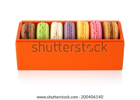 Macaroon in the orange box on white background. Dessert - stock photo
