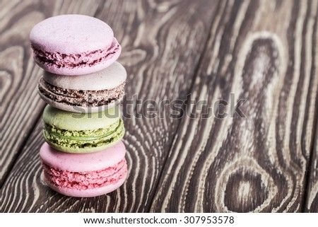macaroon on a wooden table. a focus on macaroon in the middle of the pyramid - stock photo