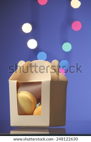 macaroon well pack in the container - stock photo