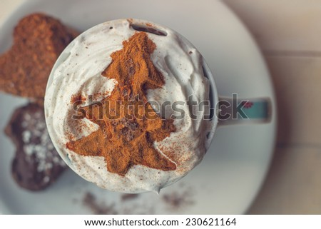 Macaroons and coffee decorated in a festive Christmas way, on a vintage white wooden tabletop. - stock photo