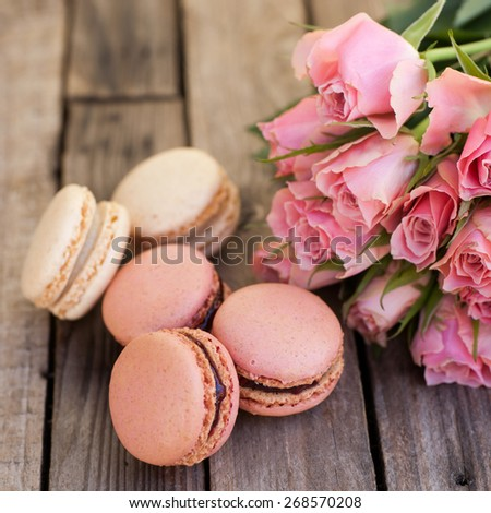 Macaroons and roses - stock photo