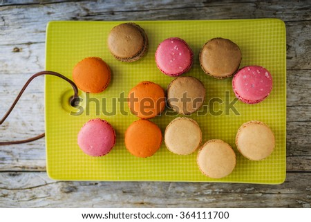 Macaroons - colored almond cookies with different flavors, French delights  - stock photo