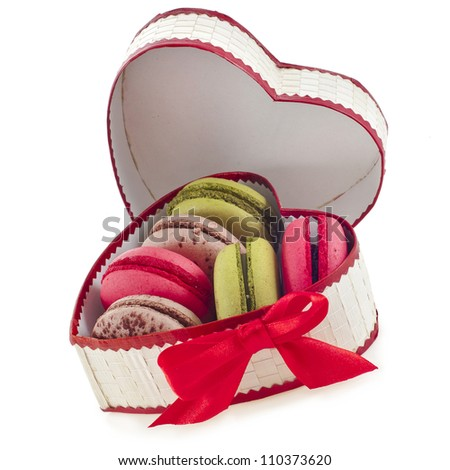 macaroons cookies on a heart box with red ribbon bow isolation on a white background - stock photo