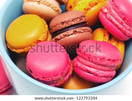 macaroons in a cup over white