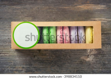 Macaroons in box on Wood background